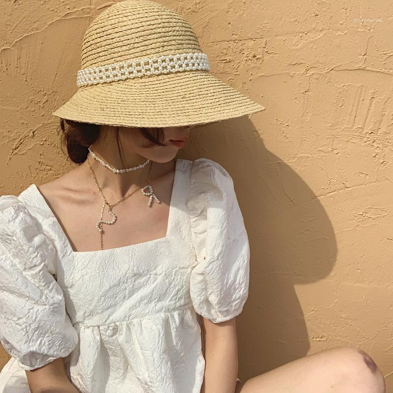 Pequeño viento dulce puro hecha a mano perla tapa nueva Paja Paja Lafite Sun Hat Bucket Hats1