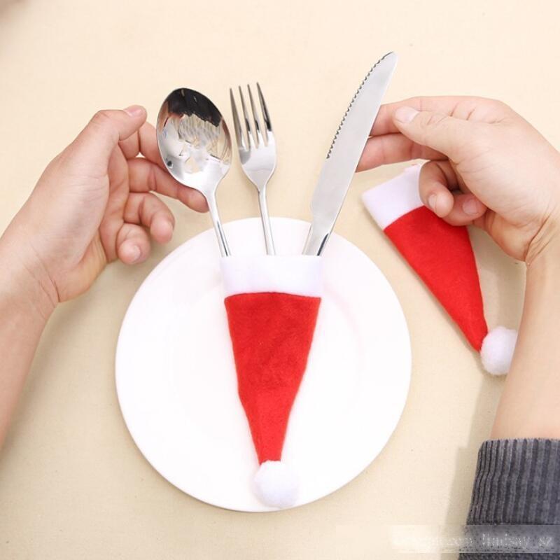 Titular de cutelaria de Natal Não-tecido chapéu vermelho tampa de garrafa de vinho garfo faca de mesa mesa de mesa decoração de bolso festa de decoração LX8623