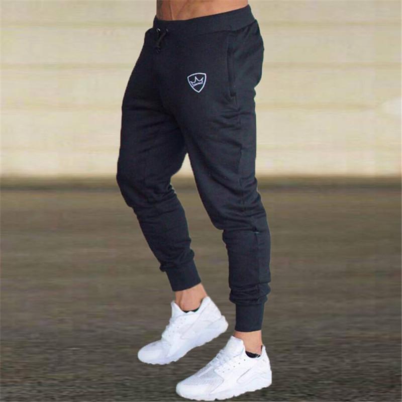 2020 NOUVEAU Pantalon de jogging Hommes Fitness joggers Courir Pantalons Hommes Formation Sport Leggings Vêtements de sport Sweatpants culturisme Collants c1118