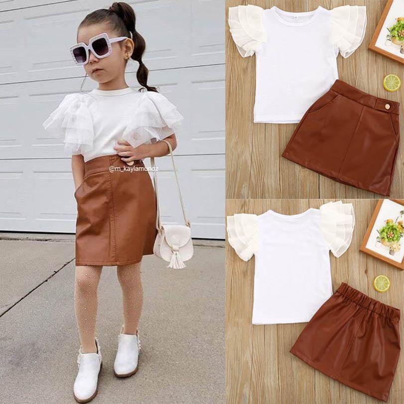 INS Summer Fashion Girls Convient aux girls Sweet Girls Tenue T-shirt à manches courtes en dentelle + Jupes en cuir PU 2PCS / Set Enfants Tenue Vêtements pour filles B2919