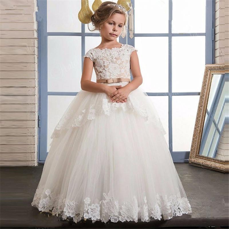 Apliques de encaje Vestidos de niña de flores para bodas Vestidos de primera comunión para chicas Champagne O-cuello sin mangas Bola de bola.