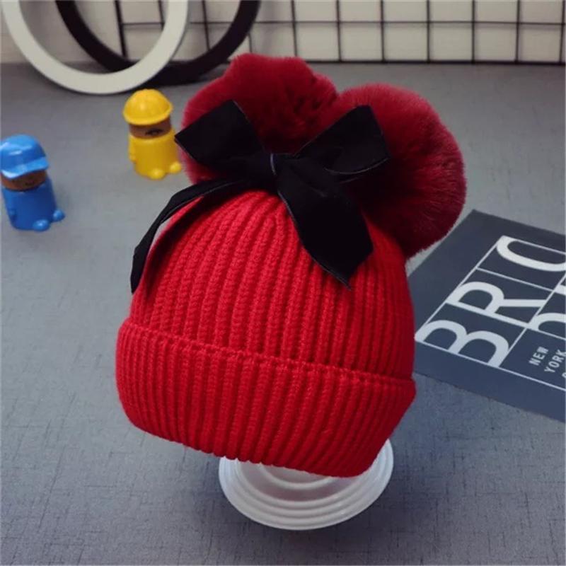 Niedliche Doppel-Pelz-Kugel-Bogen-Hüte Baby Pom Pom Mütze Kappe Kleinkind Kinder Baby Mädchen Winter Warm Häkeln Gestrickte Party Hutkappen 131 N2