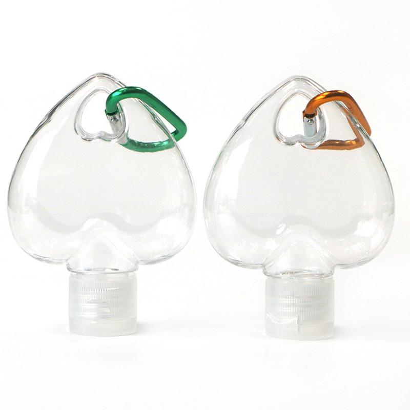Hotting 30ml 50ml Travel portatile a forma di cuore PETG PETG Plastica Mano Sanitizer Bottiglia spray con portachiavi Bottiglia di gel di alcool vuoto in magazzino
