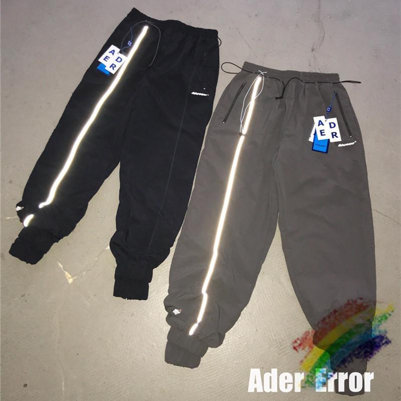 Jogger hombres raya mujer chándal tags interior reflectante lado raya pantalones pantalones pantalones de pantalones blanco qwdse