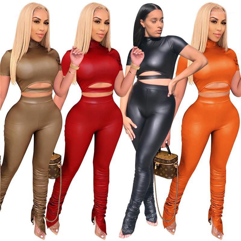 Créments de concepteur Sans manches courtes Couleur solide Sport respirant PU 2pcs Pantalon empilé Set Fashion Femme Vêtements Femmes