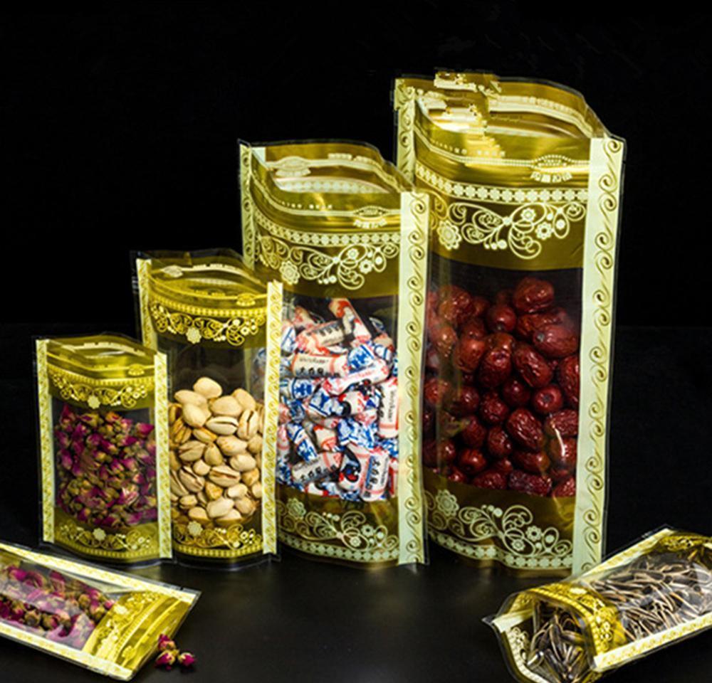 100pcs Stand up Gold Imprimer avec fenêtre Clear Fenêtre Sacs d'emballage en plastique Sacs à glissière à fermeture à glissière de fermeture à glissière Stockage des aliments Pochettes Pochettes SQCYXAF