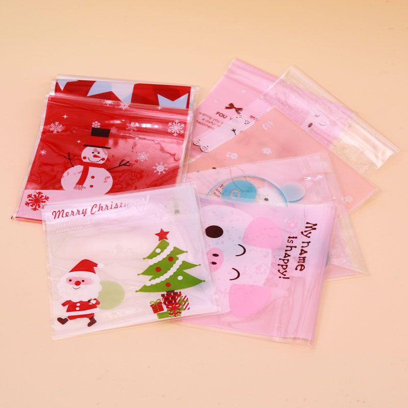 200pcs 10 * 10 + 3CM شعبية حمراء وغيرها جديدة بسيطة، جميلة وجميلة أكياس هدية عيد الميلاد تناسب dailychristmas