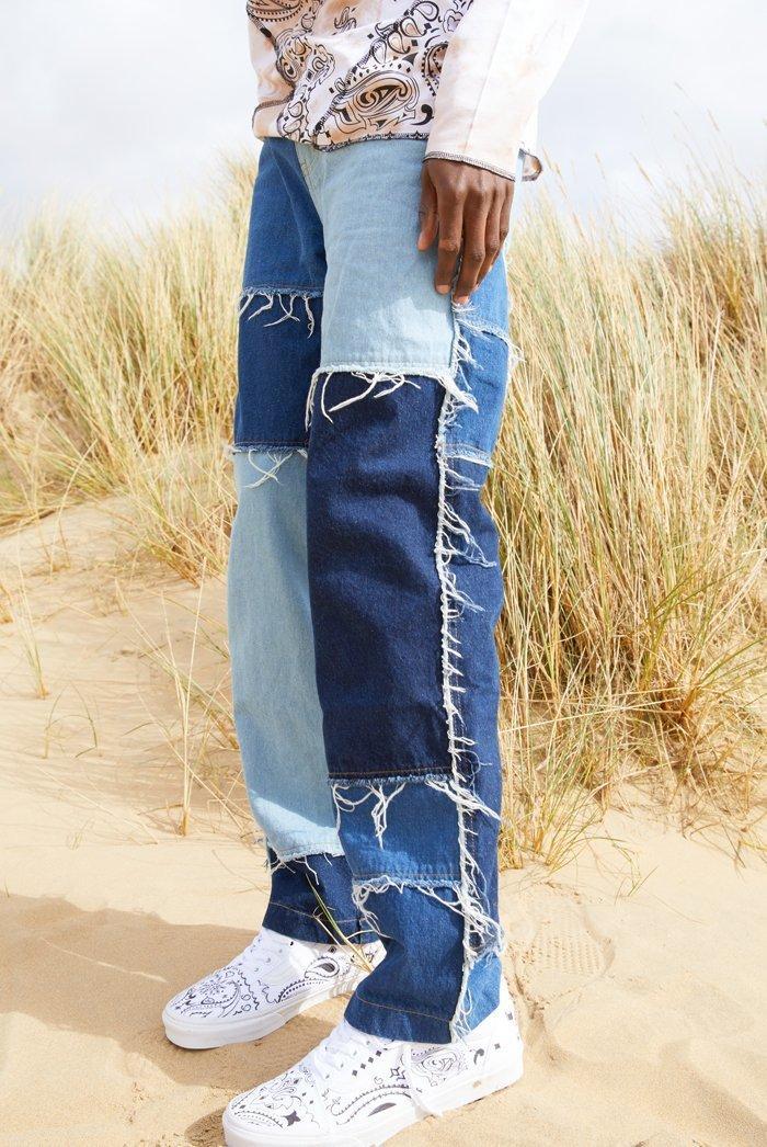 Hommes Lavez l'épissure Casual Tassel Patchwork Patchwork Jeunes Pantalons Masculin Streetwear Streetwear Loler Hip Hop Denim Pantalon