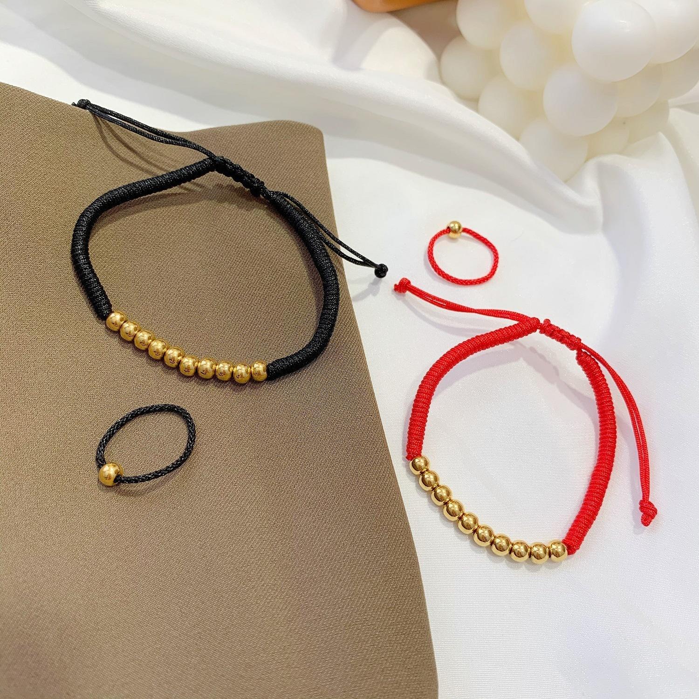 Tiktok, corda vermelha, corda preta, feijão dourado, bracelete de corrente de ouro, feminino sem cor, grânulos, mão, anel, anel.
