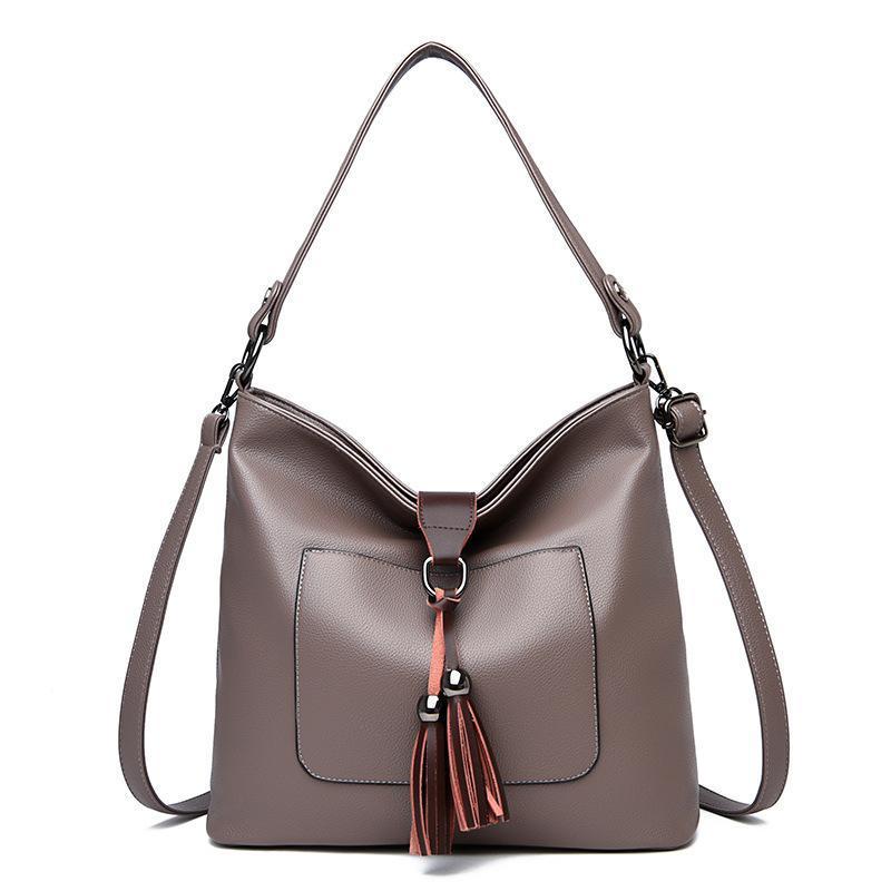 Neue weiche Frauen Große Schulter Dame Lässige Mode Leder Leder Leder Tote Quaste Taschen Taschen Handtaschen Crossbody Bag für Frauen Rkppf