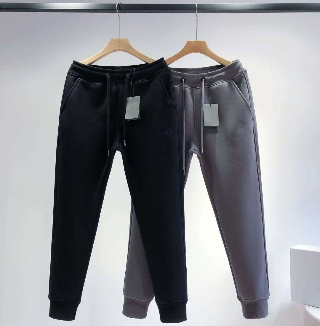 Moda Donna Casual Pants Elastico Vita Donne Casual Pantaloni lunghi Colore nero Cool Streetwear con lettere di moda taglia s m l