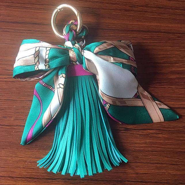 12 قطع العشرات كله حار بيع الأوشحة حامل مفتاح bowknot رائعة الديكور بو الجلود الشرابة الحلي المرأة حقيبة EH810C H jllrbj