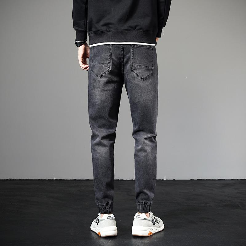 Jeans homens outono slim marca elástico coreano moda pequena perna calças espartilho casual preto macacão preto