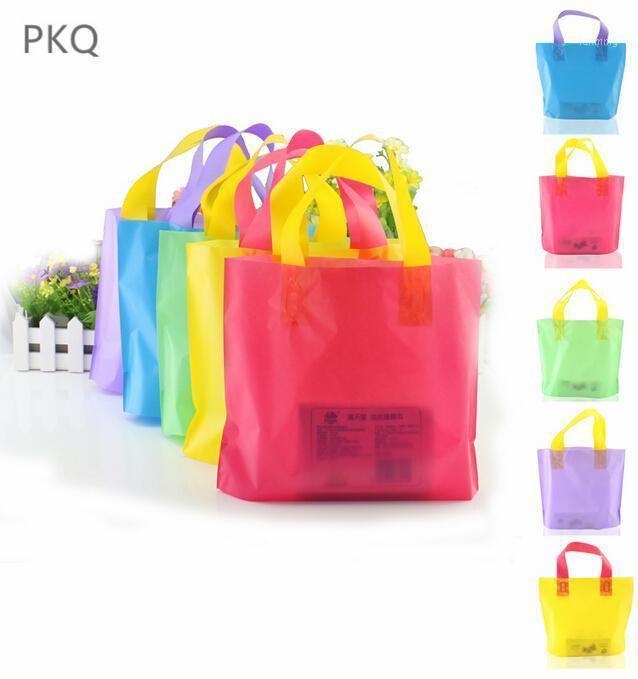 100pcs Pink Plastic Gift Bag Jewelry Boutique Packaging Bags Plastic Shopping Bags With Handle1