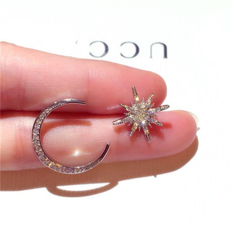 Novo pino de prata coreano com água diamante de diamante moon temperamento assimétrico brincos para fêmea E002114