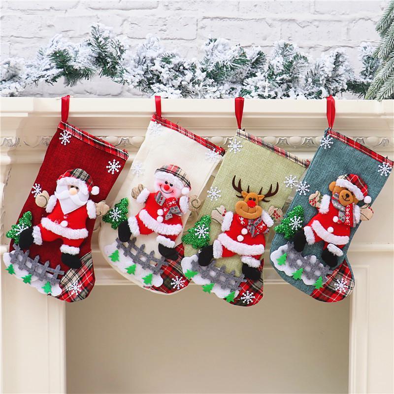 Calcetines colgantes de Navidad Bolsa de regalo de caramelo lindo Muñeco de nieve Santa Claus Deer Bear Bear Navidad Stock For Decoraciones de árbol de Navidad DHA2525