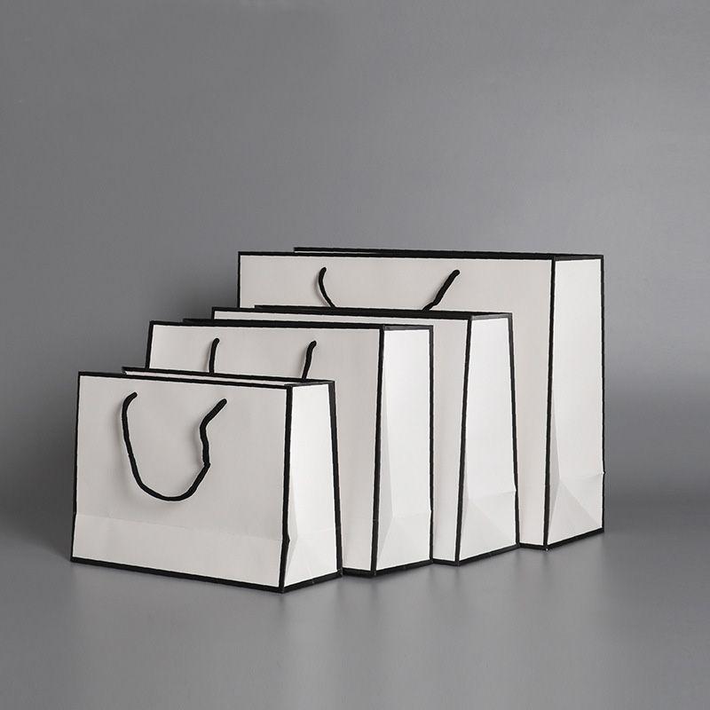 Bolsas de papel actuales Bolsas Kraft Tarjeta de embalaje Bolsa de embalaje Paño Moda de almacenamiento Bolso engrosamiento Publicidad Publicidad Personalizada HH9-3619