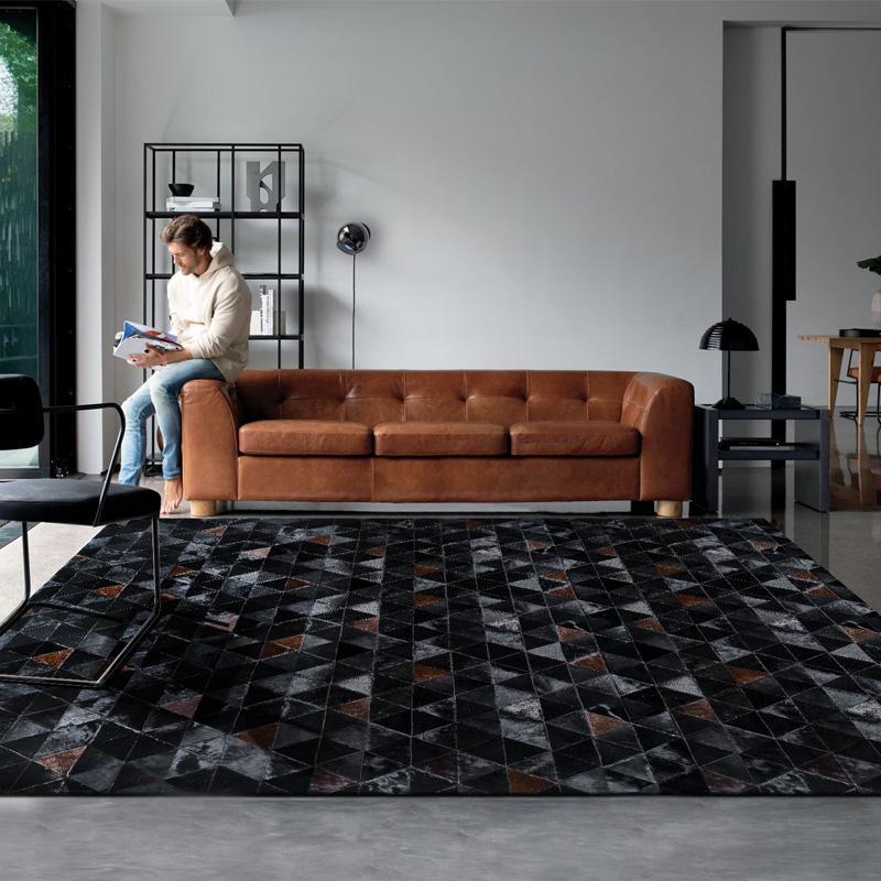 Amerikanischer Stil Luxus-Rindsleder-Patch-Arbeits-Teppich, natürliche schwarze Farbe Kuh Hautpelz-Teppich für Wohnzimmer-Dekoration Pelzmatte