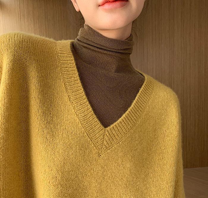 Automne et hiver Nouveau Pull de laine douce Pull à col en V femmes Pull à manches longues en vrac Couleur solide Pull en cachemire tricoté