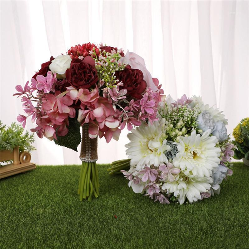 Novia sosteniendo flores boda romántica colorido ramo nupcial flor artificial flores de alta calidad fake flor para la decoración del hogar1