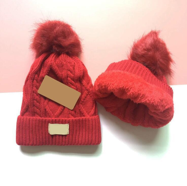 Fashion quality thick plush ball woven and plush winter warm hat for teenagers leisure boys and girls snow hat