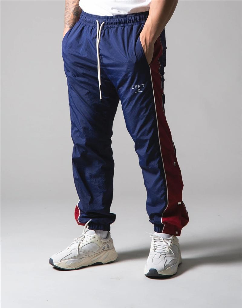 Pantaloni Uomo Quick-Dry pantaloni della tuta uomo di allenamento di ginnastica Sport Fitness Pantaloni funzionamento maschio pantaloni skinny pista di allenamento Jogger