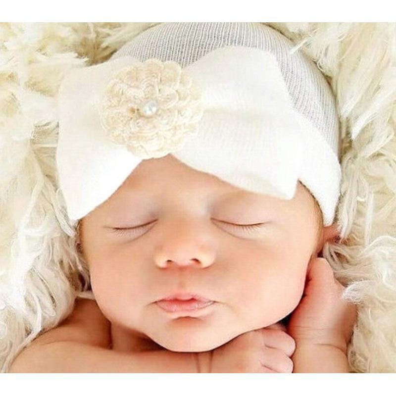 طفل الرضع القوس زهرة قبعة الوليد اللؤلؤ قبعة الكروشيه قبعات طفل الفتيات الفتيان الشتاء الدافئة القطن شريطية أغطية الرأس اكسسوارات للشعر KBH02