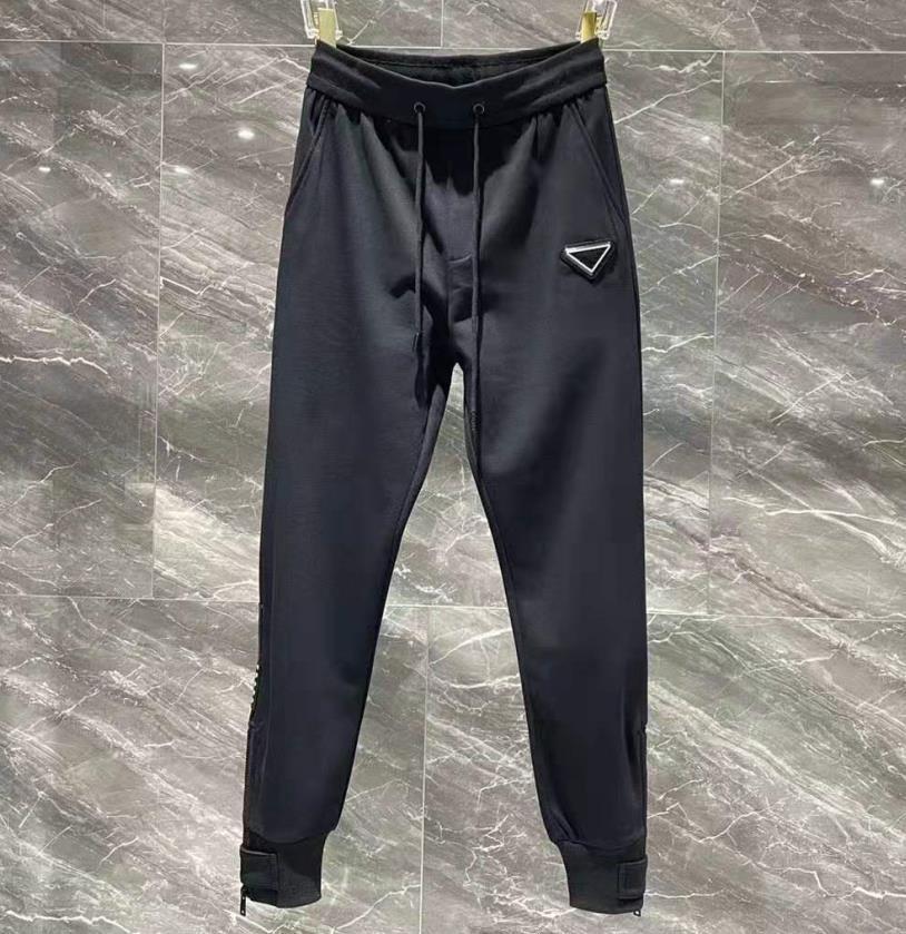 Derniers hommes Slim Classic Track Pantalons Sport Polyester Designer mâle Élastiquée Lettre Lettre Stroit imprimé Pantalon long