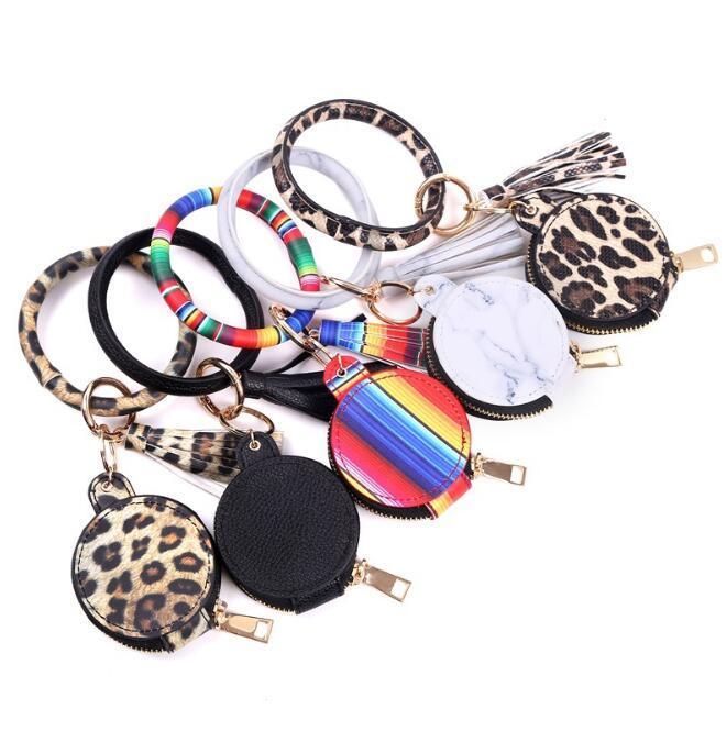 Bracelet à chaîne de clé PU Cuir Tassels Bracelets Keychain Bracelet Bluetooth Casque de rangement Boîte de rangement Sac de maquillage avec miroir Sac à écouteurs WMQ522