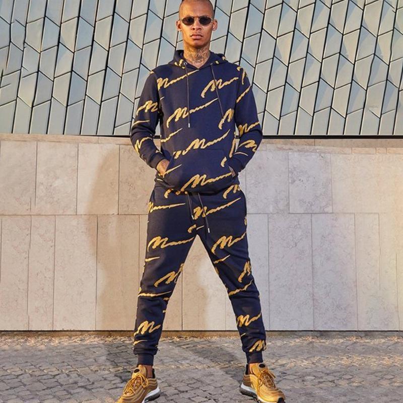 Otoño 2 piezas conjuntos chándales hombres nueva marca de invierno con capucha sudadera con capucha + pantalones de cordón raya masculina patchwork sudaderas con capucha