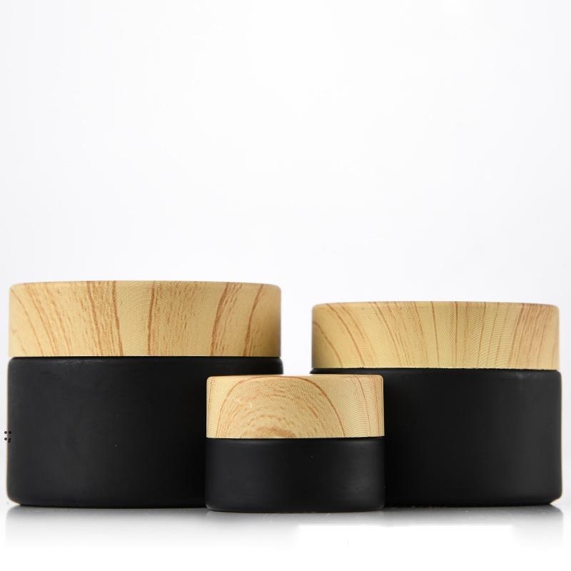 Bocons cosmétiques de pots de verre givrés noir avec des couvercles en plastique de bois PP LINER 5G 10G 15G 20G 30G 50G Bouteilles d'emballage à lèvres OWE8569