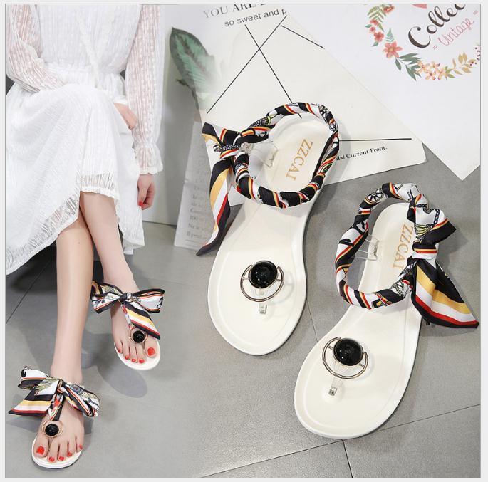 Горячие продажи - женские желе ленты лук ноги сандалии плоские каблуки сандалии летние сандалии