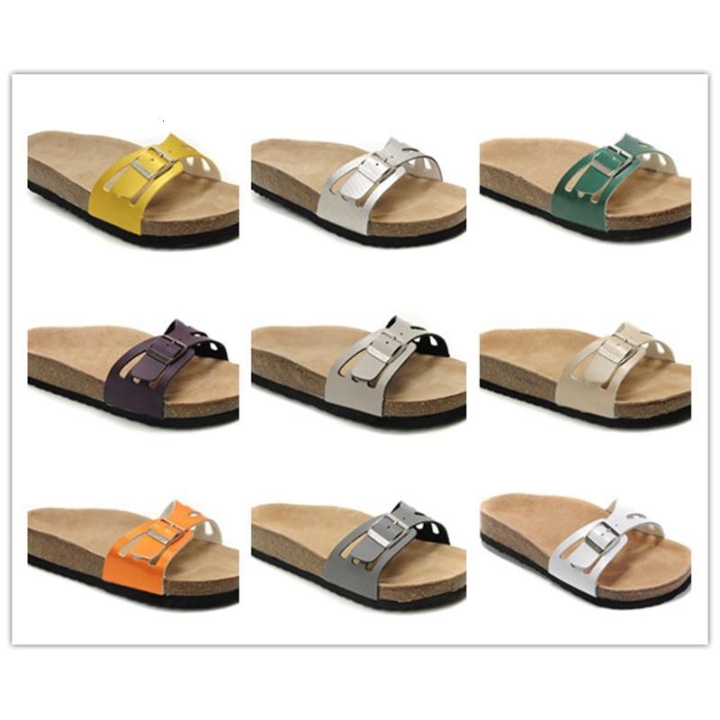 Diseñador de marca de alta calidad Zapatillas de cuero genuinas Sandalias de talón plano para mujer Venta al por mayor Playa de verano Sandalias femeninas