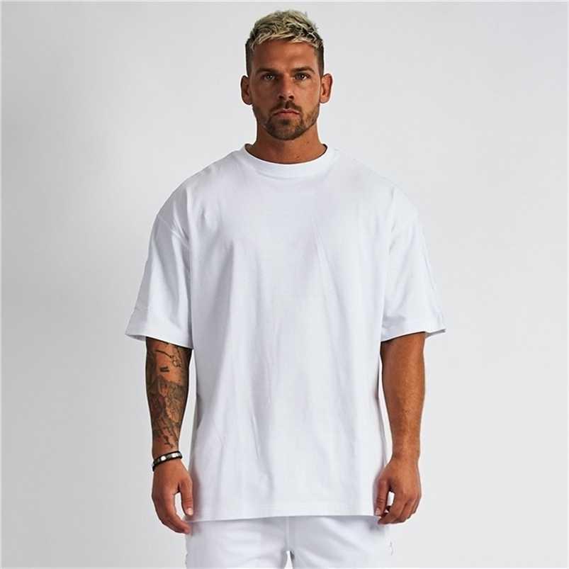 Sólida tamanho grande camiseta homens fisherbuilding e fitness tops casuais estilo de vida ginásio desgaste t-shirt masculino solto streetwear hip-hop tshirt 210329