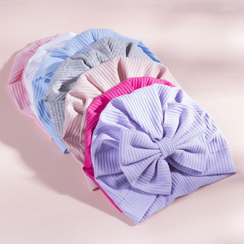 Recién nacido bebé color sólido arcos turbantes niños beanie sombrero fotografía infantil accesorios de algodón cálido bowknots tapas de gorras de cabeza