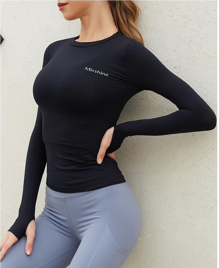 2021 Yoga para mujer Camiseta de manga larga de la manga larga ajustada altas deportes elásticos Top Top para mujer Ropa de yoga fitness sin fisuras
