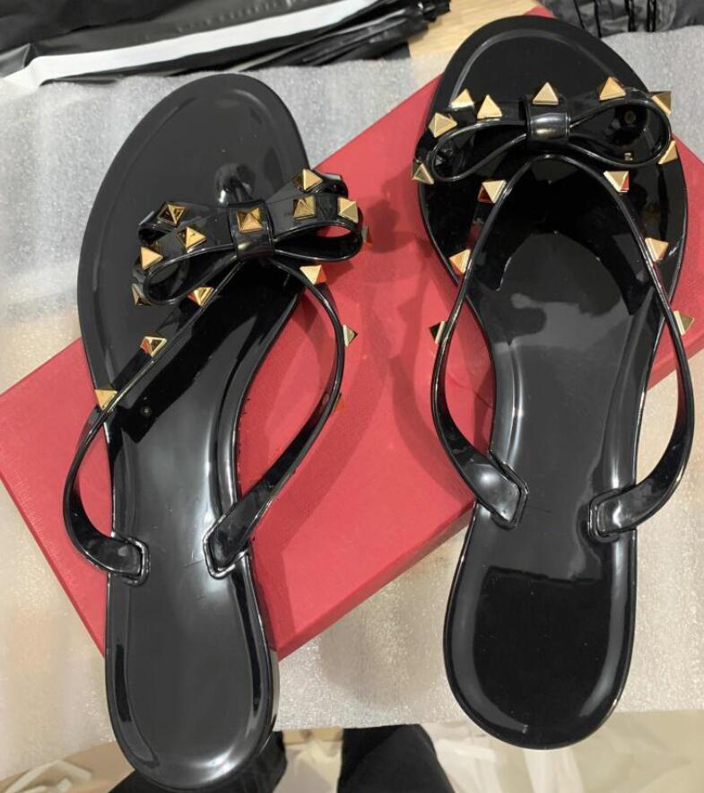 Kadın Tasarımcılar Lüks Sandalet Perçin Marka Yay Düğüm Düz Terlik Sandal Çivili Kız Jöle Platformu Slaytlar Lady Çevirme Kutusu ile 35-41