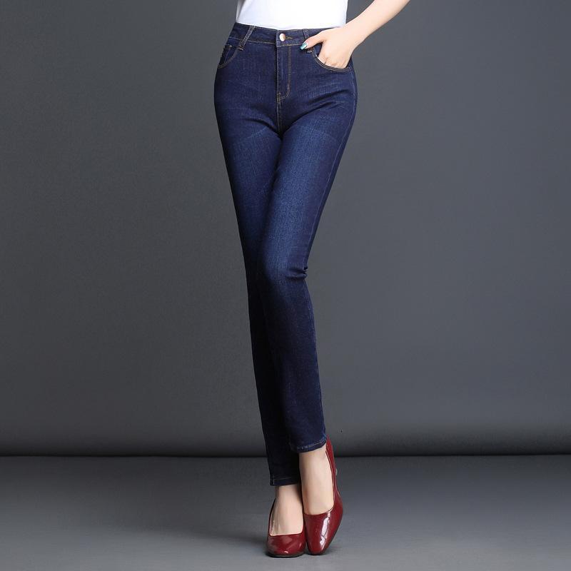 Primavera y verano alta cintura grande Tamaño de gran tamaño Jeans Pantalones de mujer Pies de lápiz Pantalones casuales rasguño
