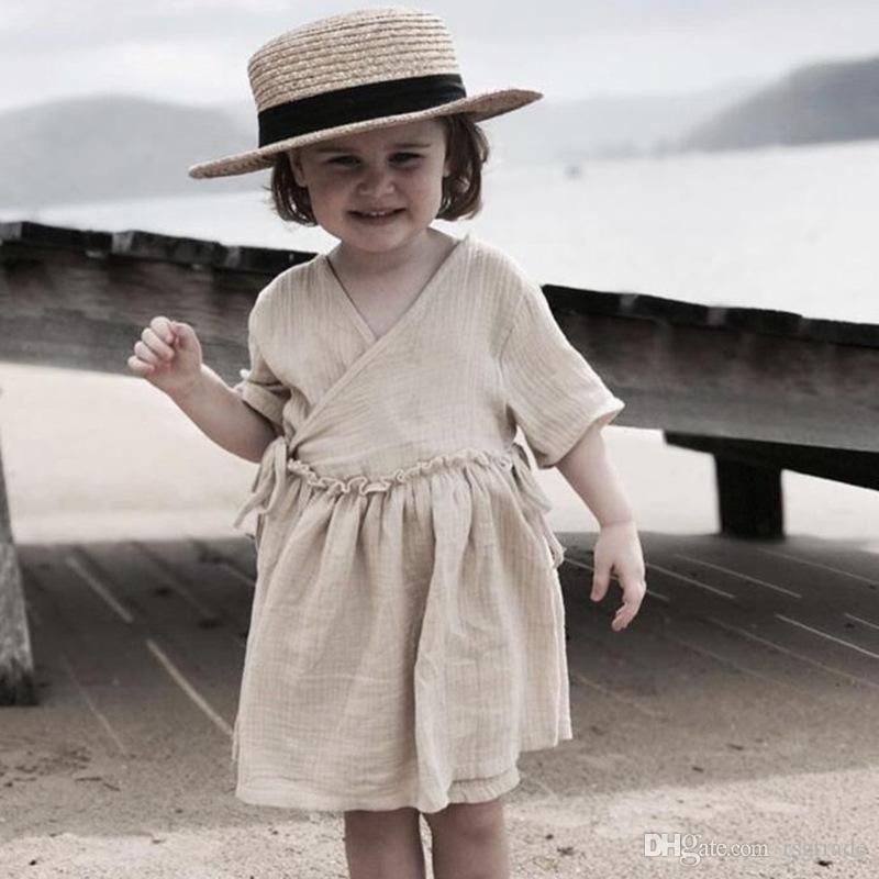 Kt أحدث الكورية أستراليا ins الفتيات الصغير الكتان العضوية القطن فساتين قصيرة الأكمام الأشرطة الأطفال