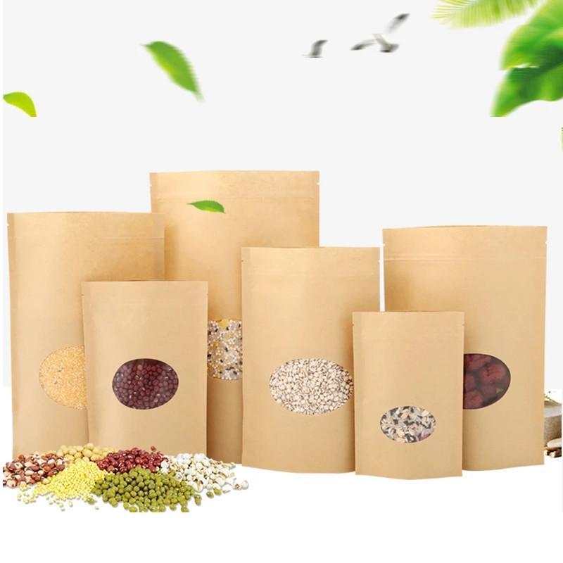 100 pçs / lote kraft papel sacos levantam malotas de alimentos reutilizáveis com janela para armazenar o pacote de alimentos secos de cookie