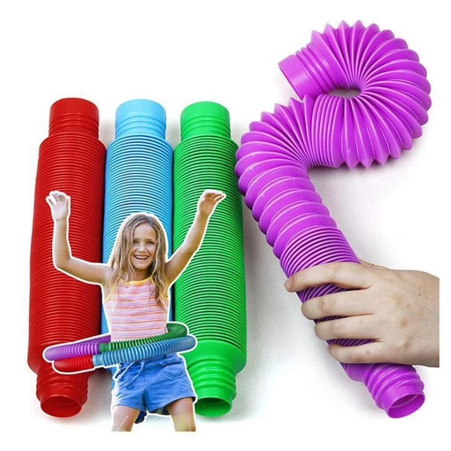 Coloré Fidget Plastique Push Tube Tube Bobine Jouets magiques Cercle Jouets drôles Développement précoce Développement Éducatif Pliage Magical Fige