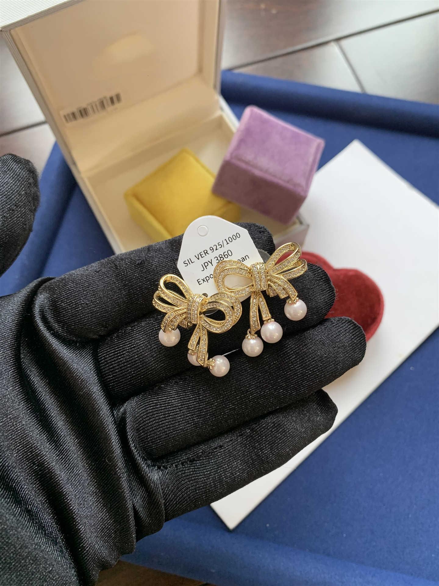 D Familia Japonés y Coreano Barroco Bowknot Pendientes de perlas Pendientes 925 Tremella Nail Net