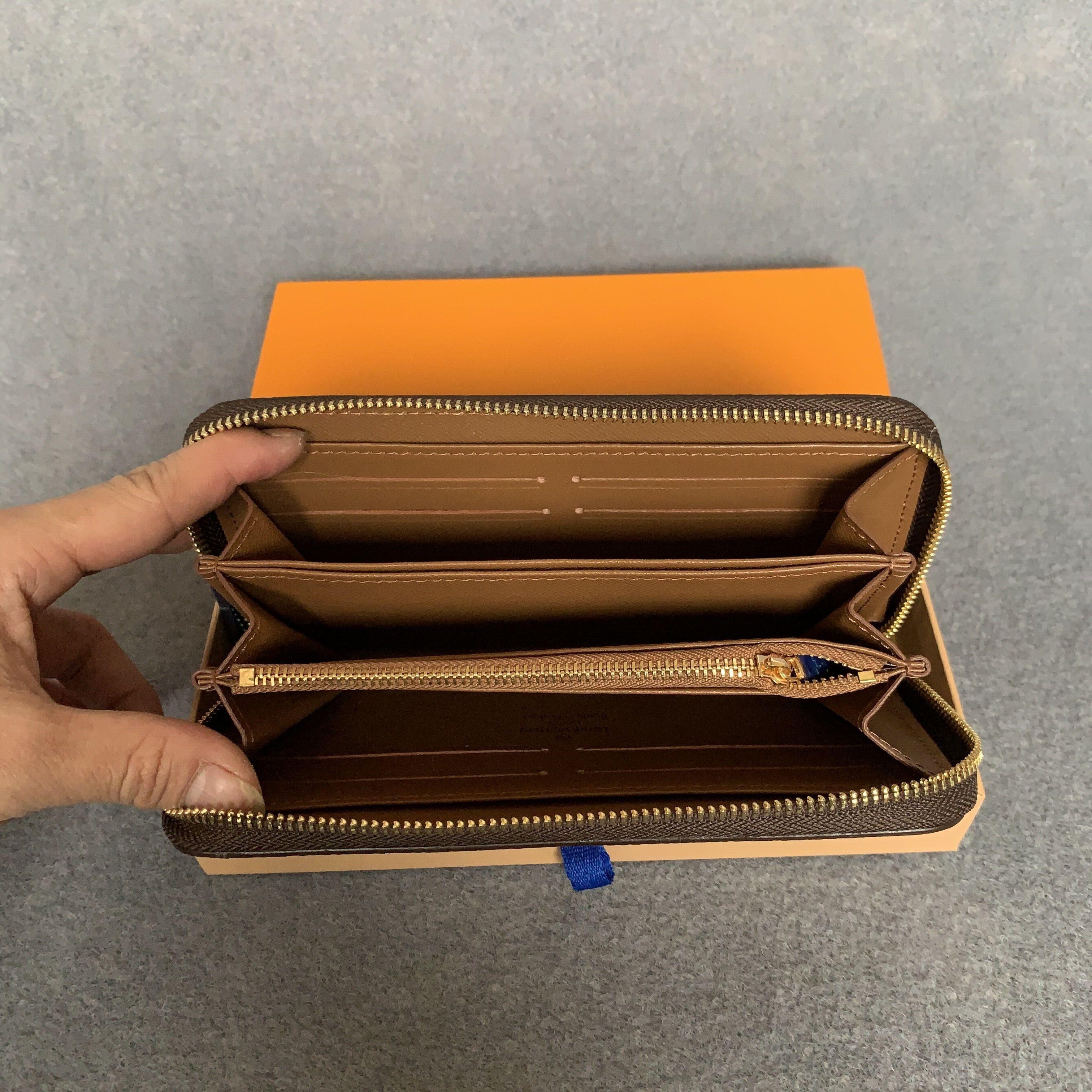 الجملة جودة عالية الأزياء محفظة واحدة سستة مصمم الرجال النساء محافظ جلدية سيدة السيدات محفظة طويلة مع بطاقة مربع البرتقال 60017