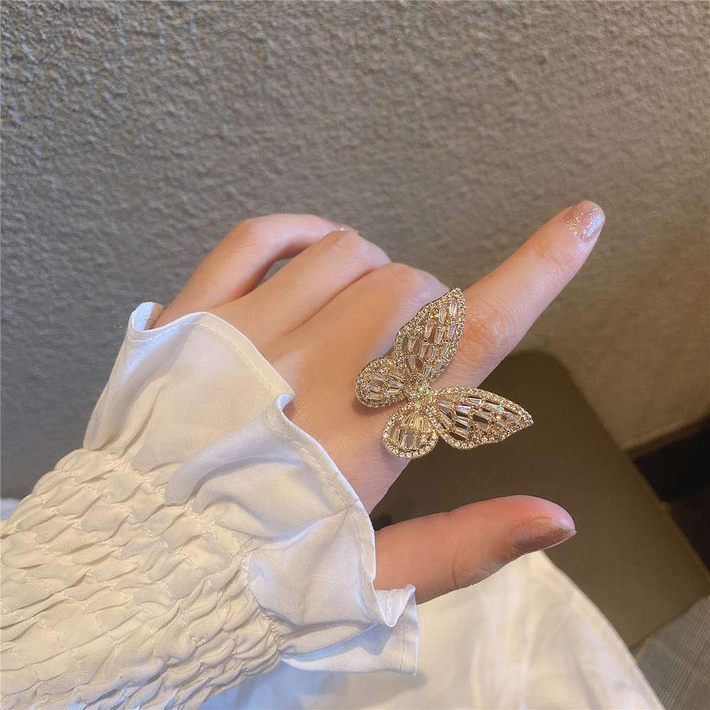 Tempérament polyvalent de zircon super grand de micro, bracelet réglable, bague papillon, anneau simple