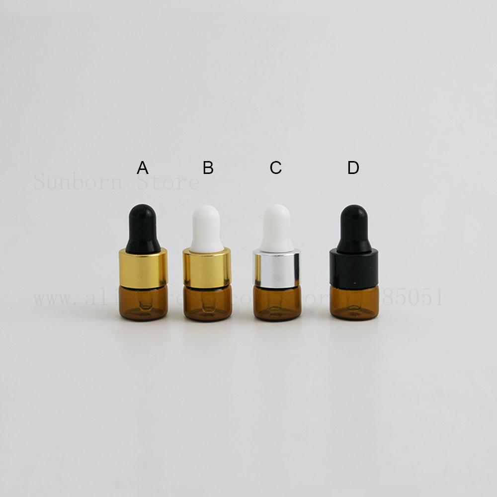 500 x Mini Botella de muestra de ámbar claro 1 ml E líquido Botellas de gotero de vidrio de aceite esencial con tapa negra de plata de aluminio