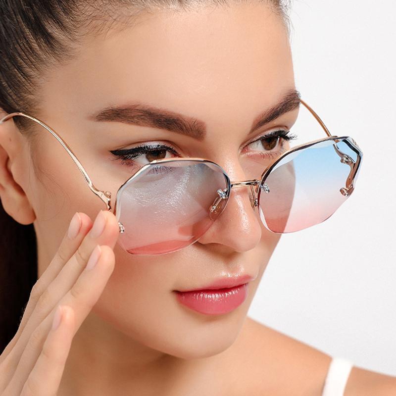 Солнцезащитные очки Женщины Мода Вырезать Металлоизображение Ноги Орисозда Rimless Градиент Солнцезащитные Очки Высококачественные аксессуары