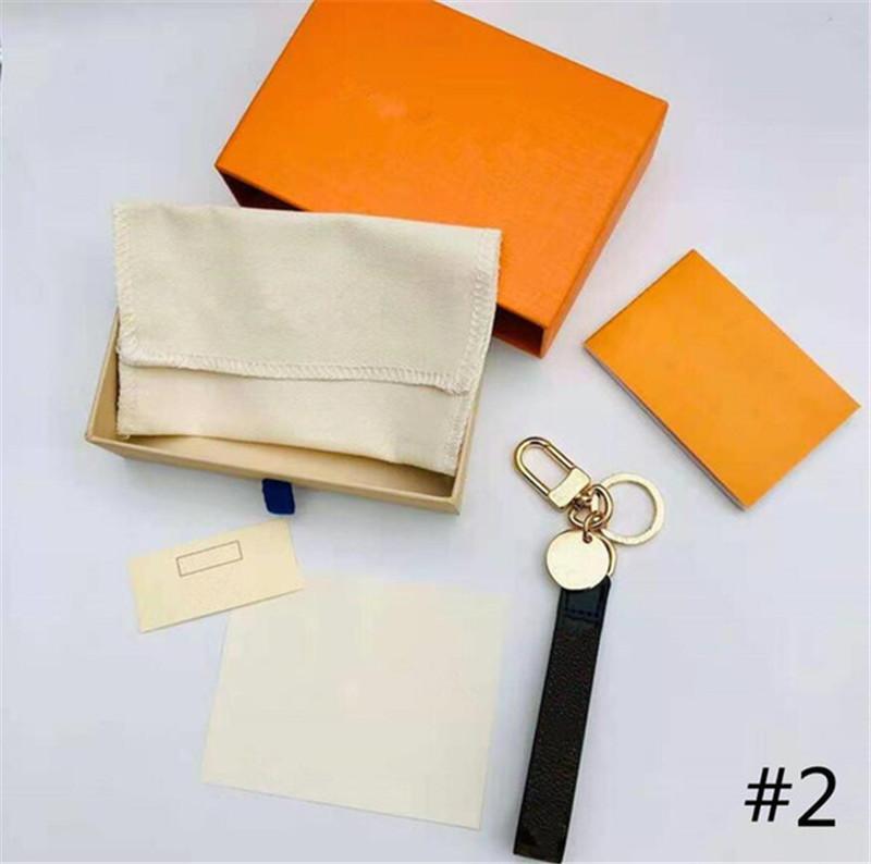 Luxurys Designer 4 Farbe Schlüsselanhänger Buchstaben Echte Mode Leder Auto Mode Schlüsselanhänger Ring Hängende Seile Schöne Brieftasche Kette Portachiavi Box