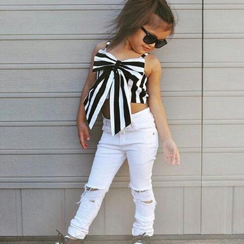 2021 Ins Kids Girls 2 Stück Kleidung Set Gestreifte ärmellose Tops Getreide Schmetterling Bogen Weste + Löcher Hosen Ripping Jeans Mode Anzug H239NMQ