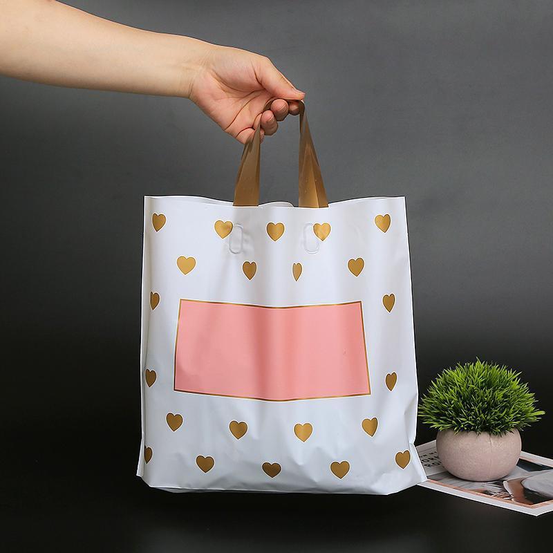 Geschenk Wrap 50pcs / lot Kunststoffeinkaufstaschen Kleidung Paket Parteiversorgung mit Griff