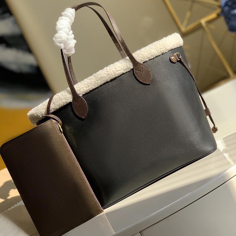 Новая интерпретация классических сумки M56960 Classic Calfskin с новым флодированием Исследуйте мелкие детали внутри сумки модные сумки